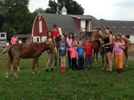 Camp students painting ponies!